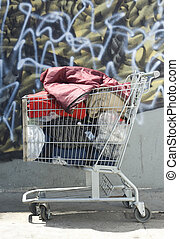 Homeless Shopping Cart - Shopping cart appropriated by a...