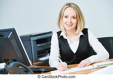 Young adult businesswoman with computer at workplace