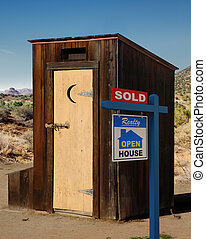 Housing Market - A realestate sign showing a dumppy...
