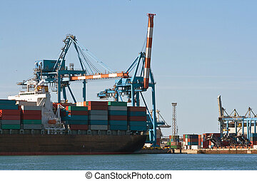 Container ship in harbor - detail of container ship in...