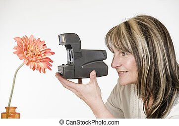 woman photograph orange flower - Lateral head-and-shoulder...