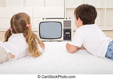 Kids watching television - Kids watching old television set...