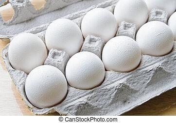 A dozen of white eggs in a box