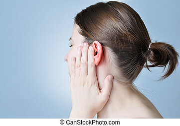 Ear inflammation - Young woman touching her inflamed ear