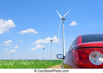 Red car and wind turbines. - Red car and wind turbines...