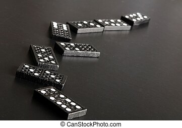 financial crisis concept with domino game on black...