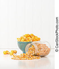 Popcorn Kernels Portrait - Jar of raw popcorn kernels with a...