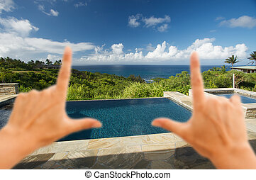 Hands Framing Oceanview Pool and Patio