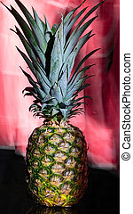 ananas fruit on red background
