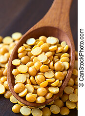 Raw Yellow Split Peas - Raw yellow split peas in wooden...