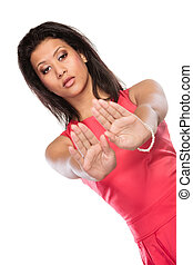 Mixed race woman showing stop sign gesture - Portrait of...