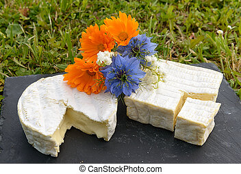 Normandie French cheese on a plate with flowers - a...