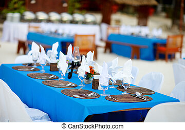 Wedding reception - Table set for a wedding reception or...