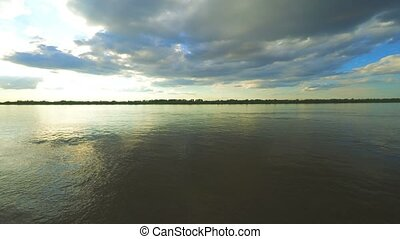 Clouds fly over a Volga-river near Astrakhan, Russia....