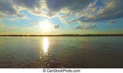 Sun setting. Sunset over a Volga-river near Astrakhan,...
