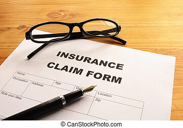 insurance claim form - insurance claim for on desk in office...