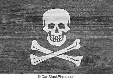 Pirate flag on a wooden plank - Flag of The Pirates on a...