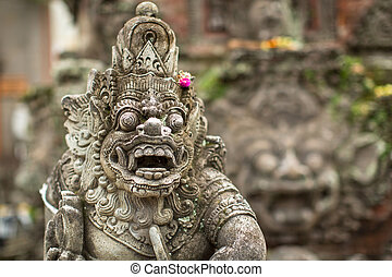 Traditional demon guard statue carved in stone in Bali...
