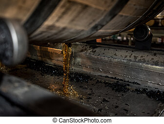 Bourbon Pouring Out of Barrel in a Kentucky distillery