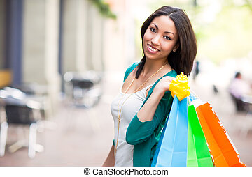 Black woman shopping - A shopping black woman carrying...