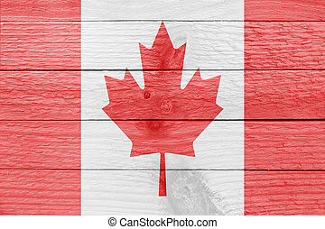 Canadian flag on a wooden plank - The flag of Canada on a...