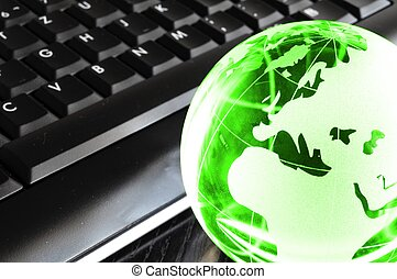 globalisation concept with glass planet on computer keyboard...