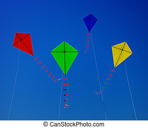 flying a kite - A kite flying in the blue sky