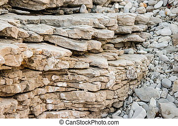 layers of eroded limestone rock - closeup of layers of...