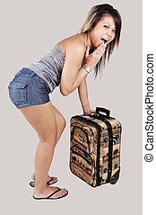 Asian girl with suitcase - A surprised Asian woman found out...