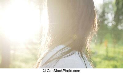 hair brunette girl develops wind at sunset - hair brunette...