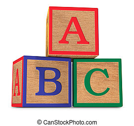 The ABCs - Wooden ABC alphabet blocks stacked on a white...