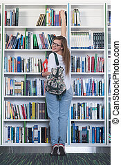 famale student selecting book to read in library - smart...