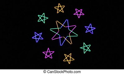 blurry light star background - light star on isolated black...