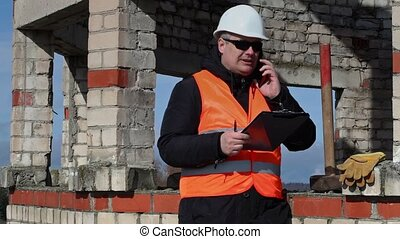Civil engineer writes and talking on tablet PC