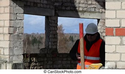 Civil engineer walking and using tablet PC