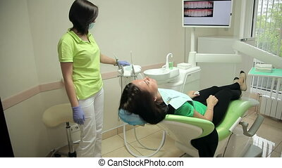 The patient is in the chair of modern dentistry - Dental...