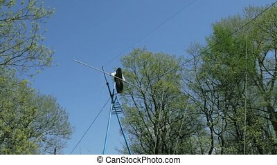 Tightrope walking on a high rope stretched - Man with...