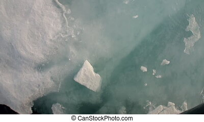 Reflection nose icebreaker and floating ice floes. in...