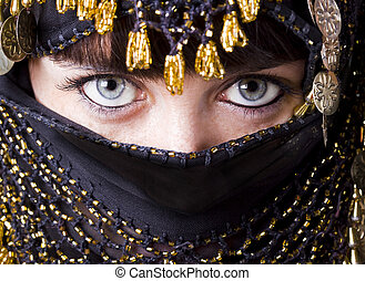 east blue eyes - woman with beautiful blue eyes behind an...