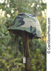 Memorial Day - Helmet resting on the stock of a rifle with a...