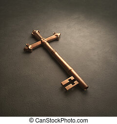 Cross Key - An old fashioned brass key laying on white...