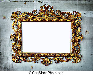 Baroque frame - Beautiful golden baroque frame hanged in an...