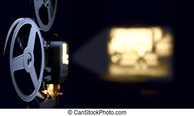 old projector showing film in dusk