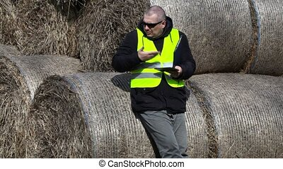 Angry Farmer near the hay bales