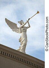 Trumpeting Angel - A trumpeting angel on top of a building...