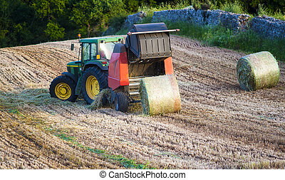 round baler is an agricultural machine used to collect and...