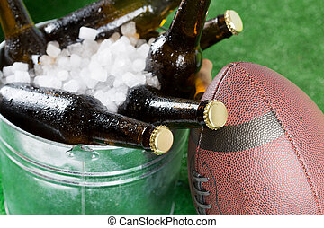 Very cold beers - American football with a cold beer in a...