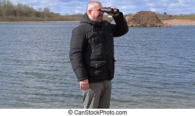 Man watching the birds at the lake
