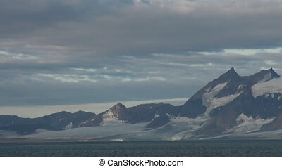 Snowy mountains and the sea in Arctic. Iceland.