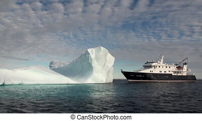 A large iceberg and the ship in the Arctic Fantastic...